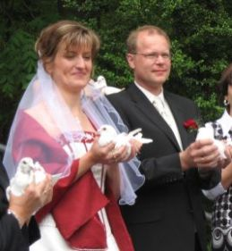 Releasing white doves after the wedding