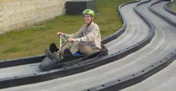 Becky riding the land luge at the Skyline